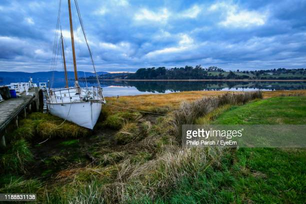 sailboats moored on lake against sky - launceston australia stock pictures, royalty-free photos & images
