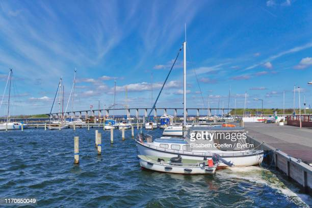 sailboats moored on sea against sky - funen stock pictures, royalty-free photos & images