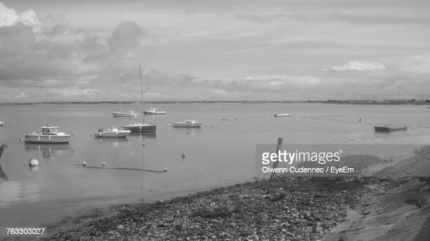 Sailboats Moored On Sea Against Sky