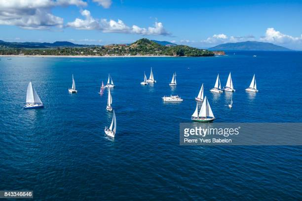 sailboats offshore nosy be - catamaran race stock photos and pictures