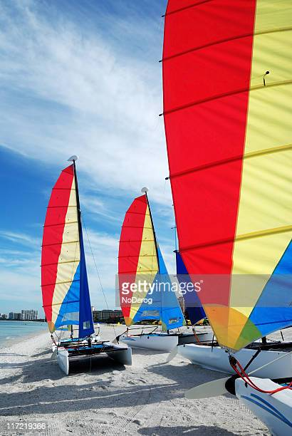 sailboats on beach - catamaran sailing stock photos and pictures