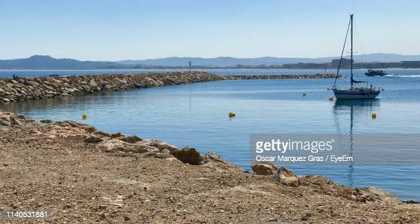 sailboats on sea against clear blue sky - gras stock pictures, royalty-free photos & images