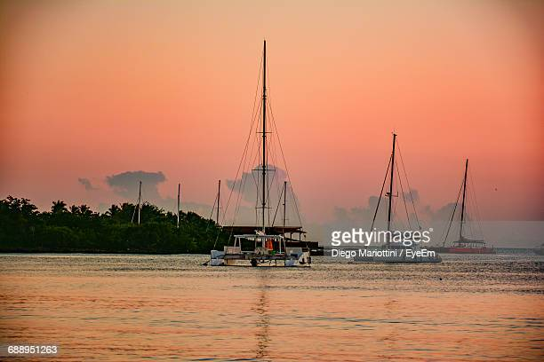 Sailboats On Sea Against Sky During Sunset