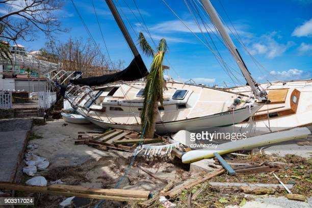 sailboats on shoreline hurricane irma downtown cruz bay, st john - spoil system stock pictures, royalty-free photos & images