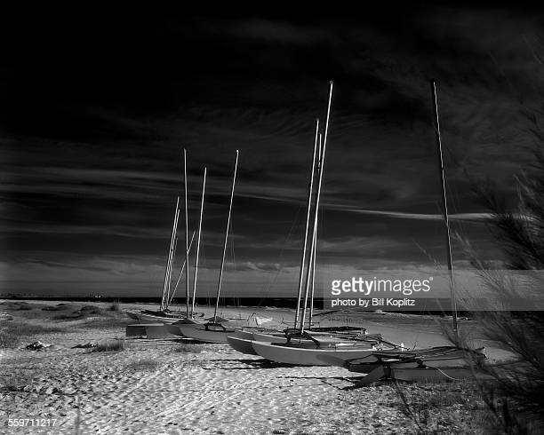 sailboats on the beach - siesta key stock photos and pictures