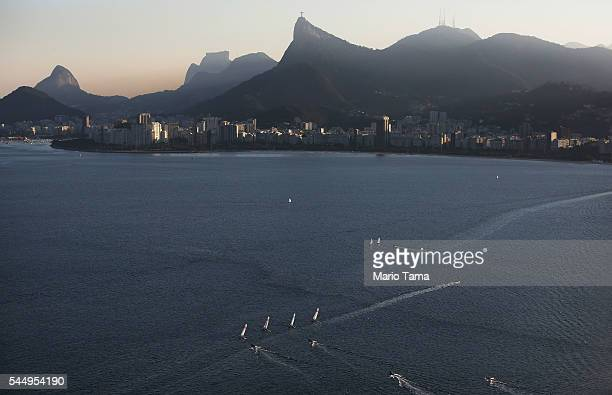 Sailboats sail in the polluted Guanabara Bay venue site of the Olympic sailing events on July 4 2016 in Rio de Janeiro Brazil July 5 marks the...