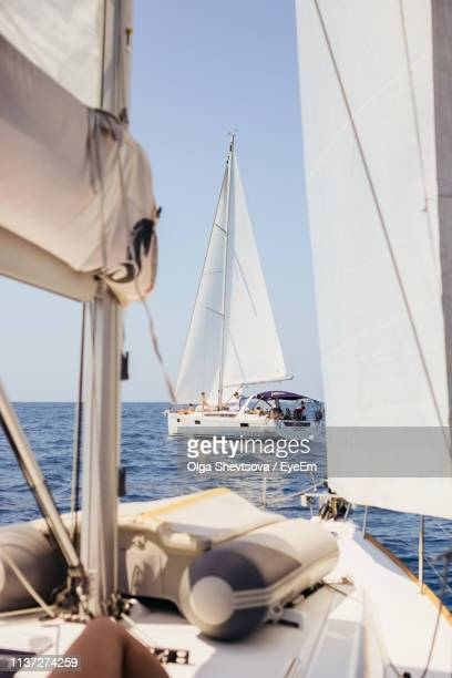 sailboats sailing in sea against sky - sea life stock pictures, royalty-free photos & images