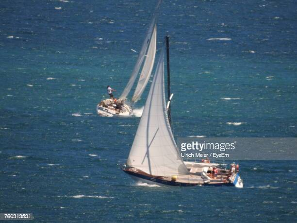 sailboats sailing on sea - nyon stock pictures, royalty-free photos & images