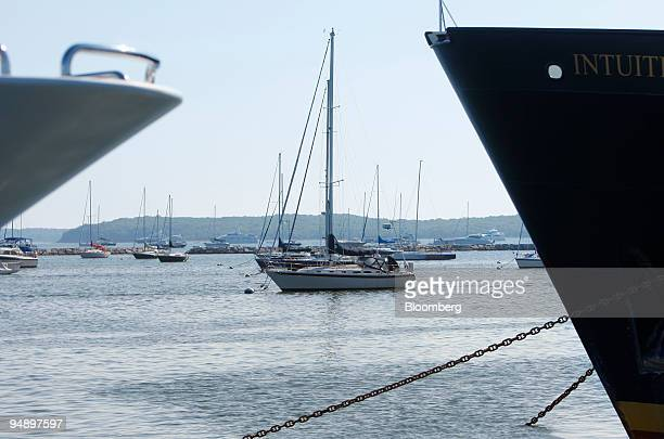 Sailboats sit docked in Sag Harbor Bay in Sag Harbor New York US on Sunday Aug 31 2008 The business district of the town is listed in the National...