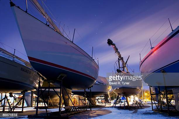 sailboats stored for winter at night - kingston ontario stock photos and pictures