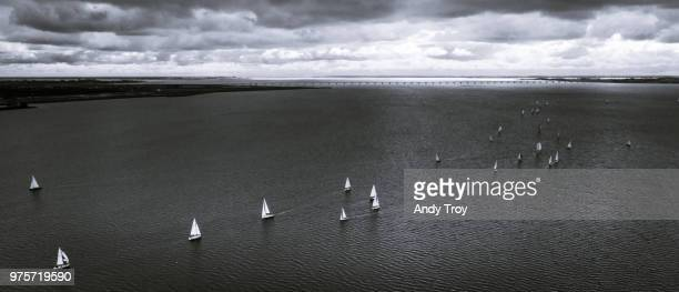 sailboats under cloudy sky, zeeland, netherlands - voilier noir et blanc photos et images de collection