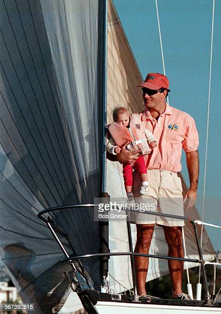 LSSailfashionpolo4BG12Feb98––John Marston holds his daughter Amanda on the bow of a sailboat making its way up Newport Harbor wearing LW regatta...