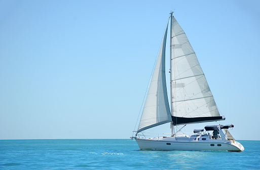 sailing a boat in the gulf of mexico 956066608