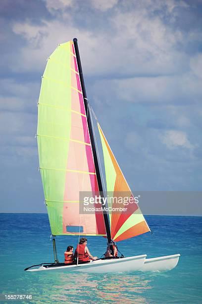 sailing at the beach - catamaran stock photos and pictures