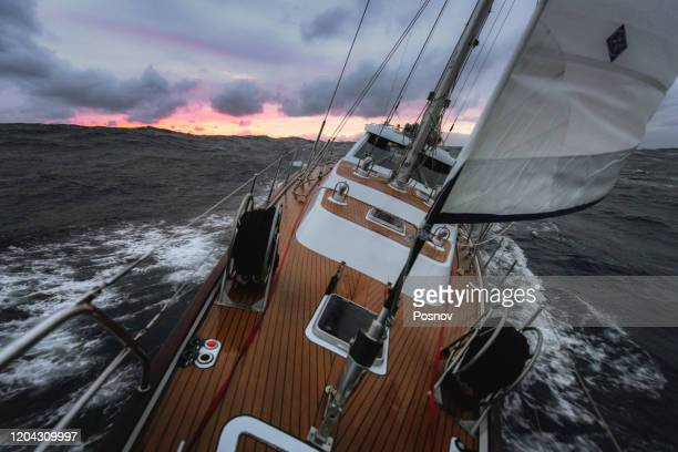 sailing at the stormy sea in north atlantic - sailing stock pictures, royalty-free photos & images