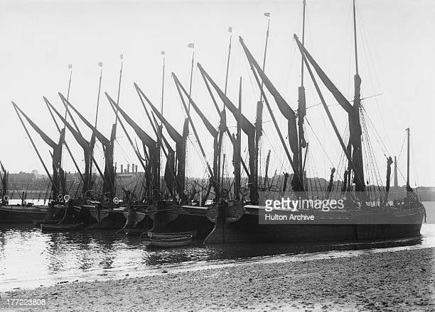 Sailing barges moored on the Thames at Greenwich London circa 1930