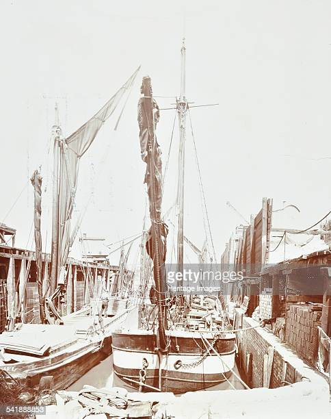 Sailing barges Nine Elms Wharf Battersea London 1906 These barges are moored on the River Thames at Messrs AH Lavers' wharf looking north Artist...