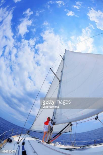 Sailing  Beautiful  woman relaxing in sunshine on the  sailing ship