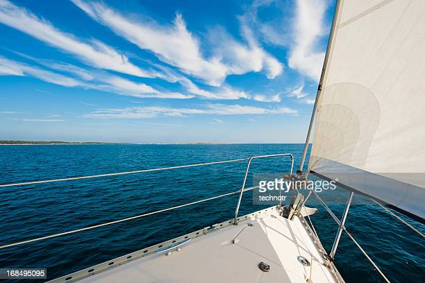 Sailing boat against the blue sky