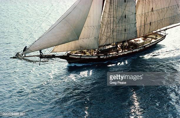 sailing boat at sea, sunrise, aerial view - crew stock-fotos und bilder