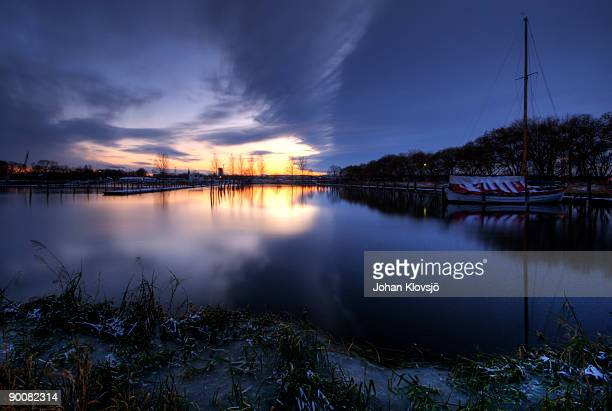 Sailing boat harbour on a wintry sunset