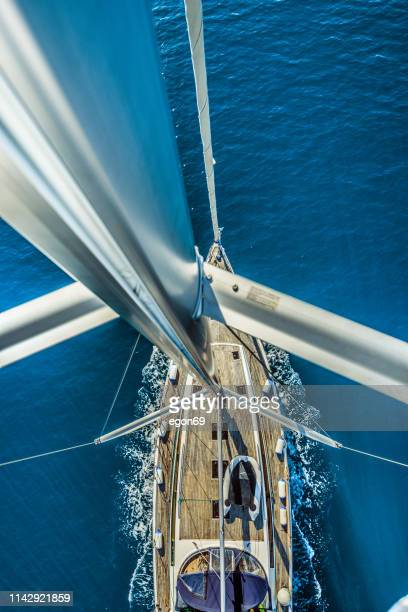 sailing boat in deep blue sea - sailing stock pictures, royalty-free photos & images