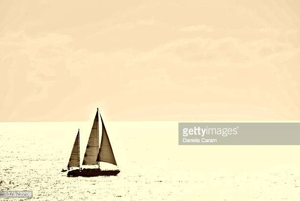 sailing boat in sea at sunset - carlsbad california stock pictures, royalty-free photos & images