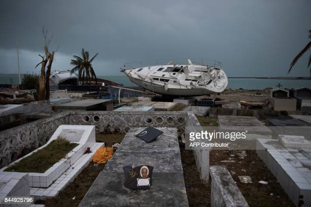 TOPSHOT A sailing boat is beached in the cemetery of Marigot on September 9 2017 in SaintMartin island devastated by Irma hurricane Officials on the...