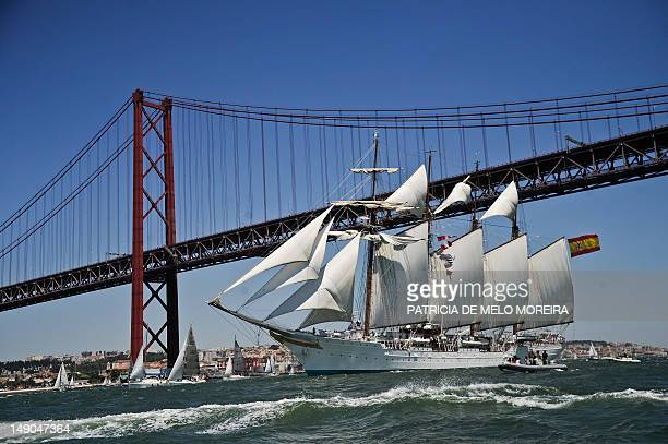 Sailing boat Juan Sebastian De Elcano sails at the Tejo River in Lisbon on July 22 during the Tall Ships' races 2012 an international event which...