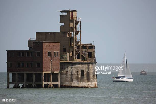 A sailing boat makes it's way past Grain Tower a mid19thcentury gun tower on the Isle of Grain on August 31 2016 in Isle of Grain England The Isle of...