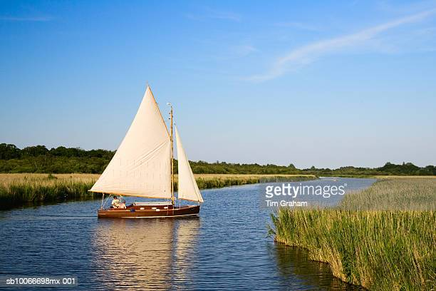 sailing boat, norfolk broads, uk - canal stock pictures, royalty-free photos & images