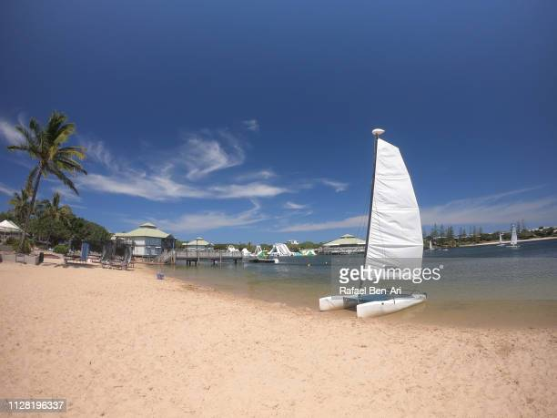 sailing boat on a lake - rafael ben ari stock pictures, royalty-free photos & images