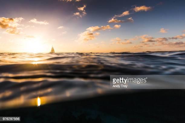 Sailing boat on ocean at sunset, Bonaire, Caribbean