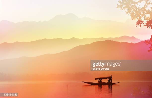 sailing boat on the alpine lake, abstract misty mountain range colourful wallpaper digital art gradiant pastel dramatic backdrop - jammu and kashmir stock pictures, royalty-free photos & images