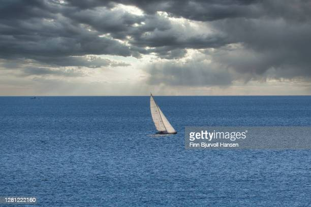 sailing boat out in the open sea - finn bjurvoll stock pictures, royalty-free photos & images