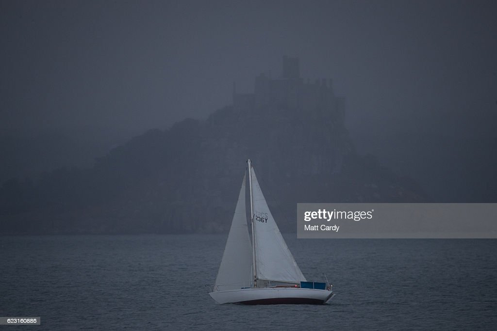 A sailing boat passes in front of St Michael's Mount near Penzance in Mount's Bay shortly before the rising of a supermoon which was obscured from view by rain clouds on November 14, 2016 in Cornwall, England. A Supermoon occurs when the perigee (closest approach by the Moon to Earth) coincides with it being full (completely illuminated by the Sun). The moon this time was expected to appear 7% larger and 15% brighter than normal. Although the next Supermoon will occur next month, the moon won't be this close to Earth again until November 2034.