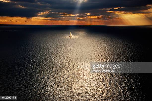 Sailing boat sailing in the deserted ocean