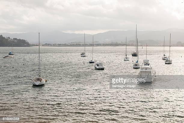 sailing boats moored in bay of bayona - provincia di pontevedra foto e immagini stock