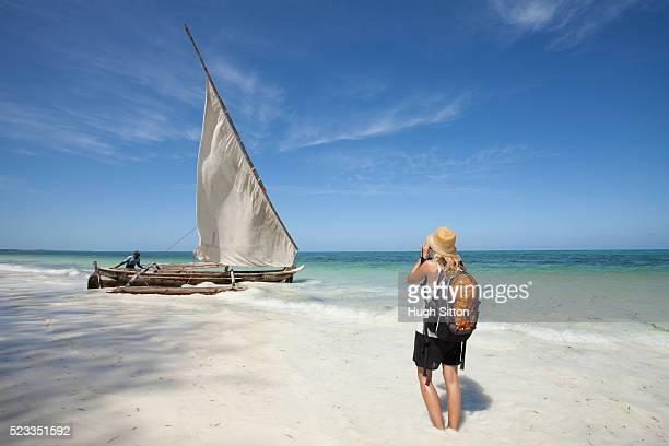 sailing boats off the coast of zanzibar. tanzania. africa. - hugh sitton bildbanksfoton och bilder