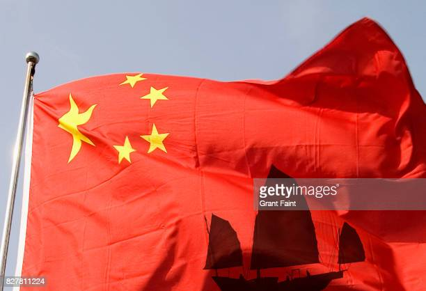 Sailing Chinese junk and Chinese flag.