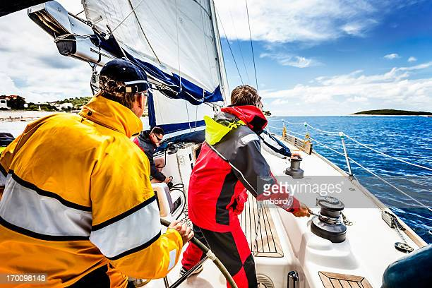 sailing crew beating to windward on sailboat - sailing team stock pictures, royalty-free photos & images
