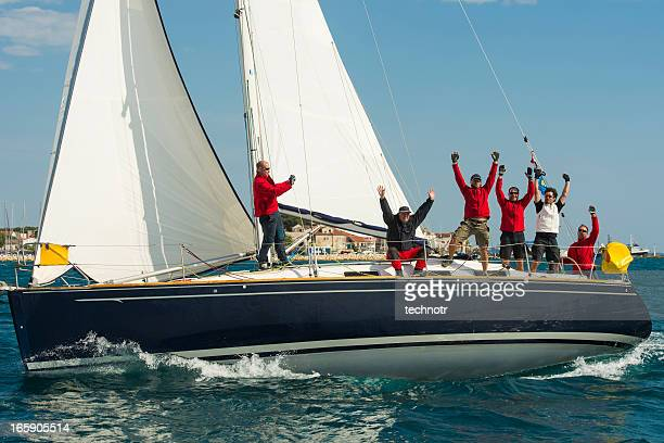 sailing crew celebrating the victory - sailing team stock pictures, royalty-free photos & images