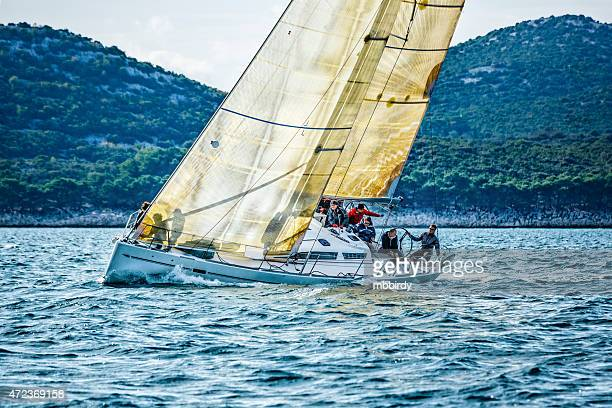 sailing crew on sailboat during regatta - crew stock pictures, royalty-free photos & images