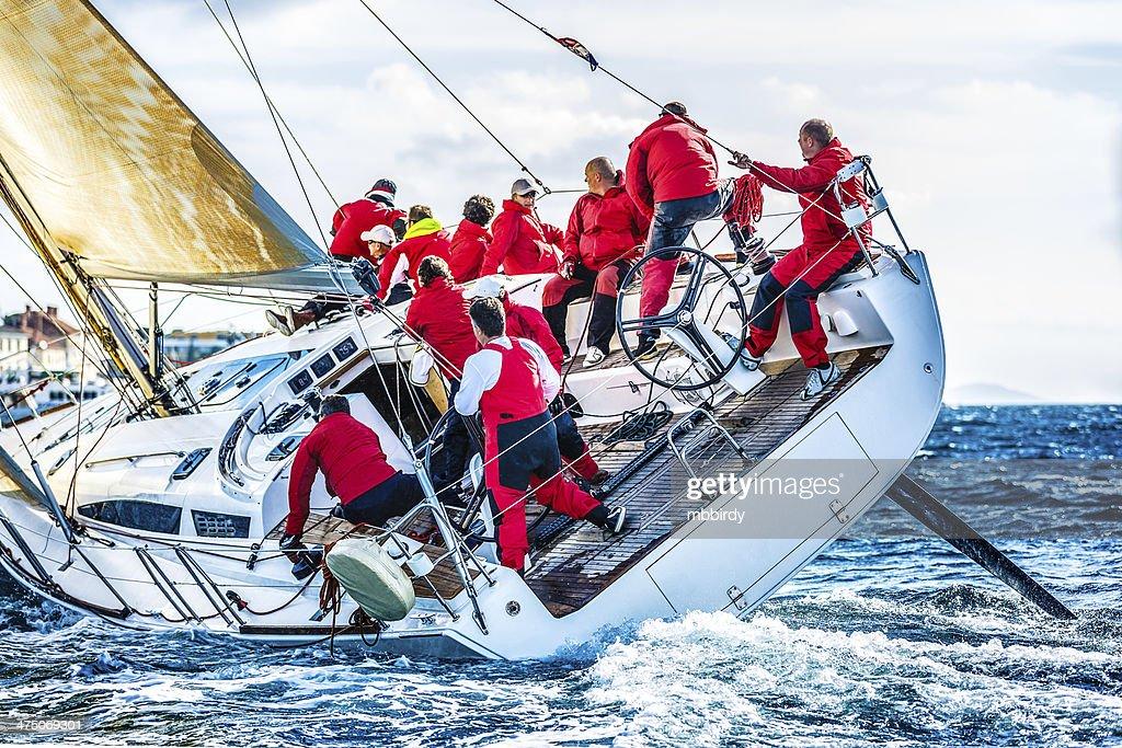 Sailing crew on sailboat during regatta : Stock Photo