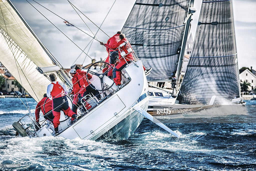Sailing crew on sailboat during regatta : Stock Photo