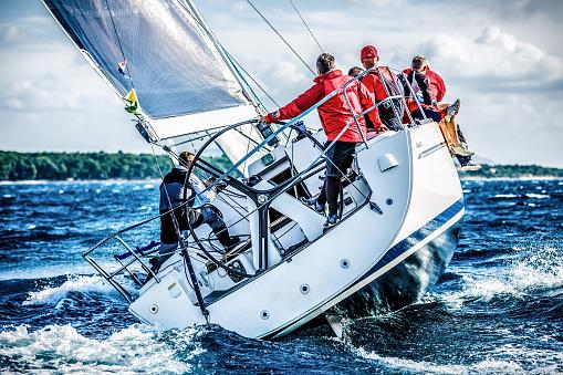 Sailing crew on sailboat during regatta 483188233