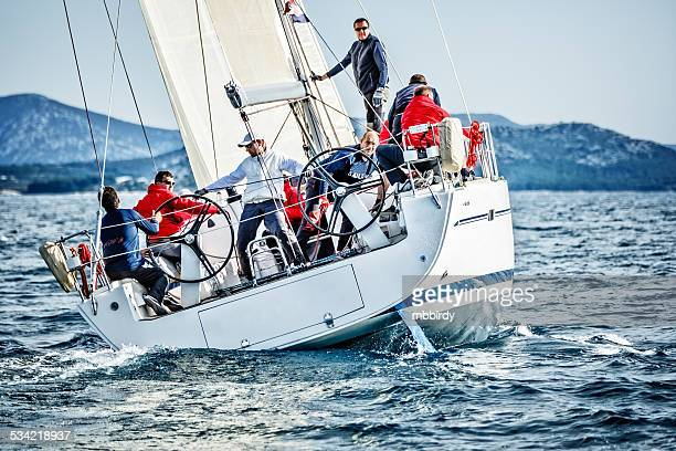 sailing crew on sailboat during regatta - sailing team stock pictures, royalty-free photos & images