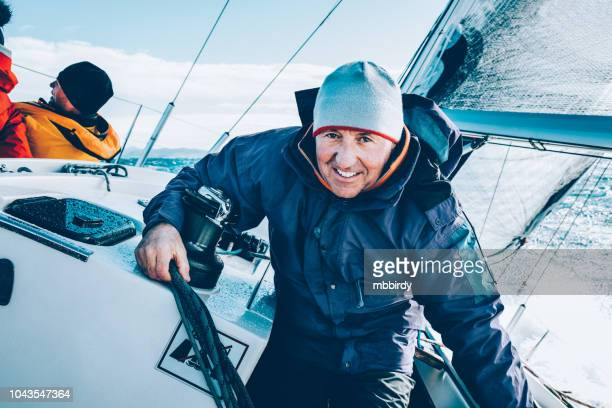 sailing crew on sailboat on regatta on sunny autumn morning - sailing team stock pictures, royalty-free photos & images