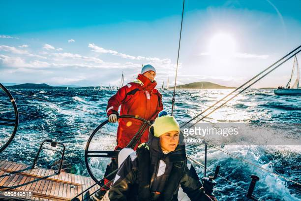 sailing crew on sailboat on regatta on sunny autumn morning - sailor stock pictures, royalty-free photos & images