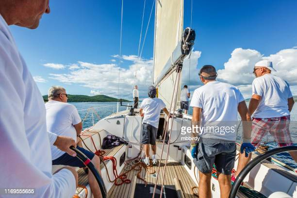 sailing crew on sailboat on regatta - sail boom stock pictures, royalty-free photos & images